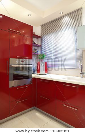 Luxury kitchen with red and marble elements