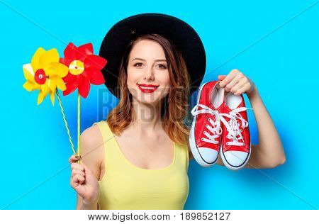 Woman With Pinwheels And Gumshoes