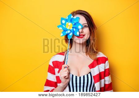 Woman With Pinwheel Toy