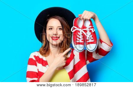 Woman With Red Gumshoes