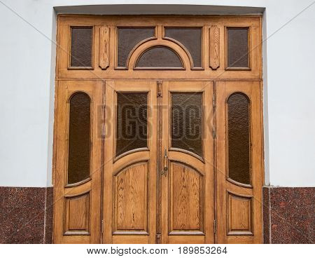 Big Old Wooden Door With White Wall