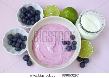 Delicious yogurt with blueberries and lime- sweet fruit dessert.