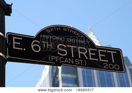 The 6th Street road sign.  6th Street is the party strip in Austin, Texas.  Parties, Live Bands, Bars, Clubs, ... its all happening on 6th Street.