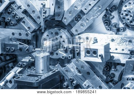 The coil spring manufacturing machine in light blue scene