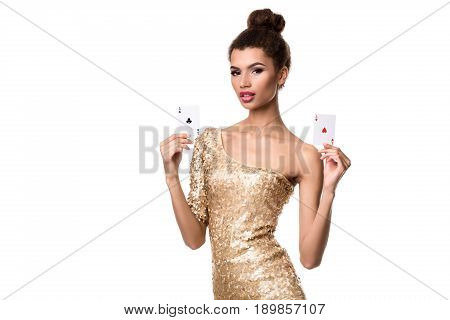 Beautiful young woman holding two ace of cards in her hand isolated on white. Studio shot. Poker