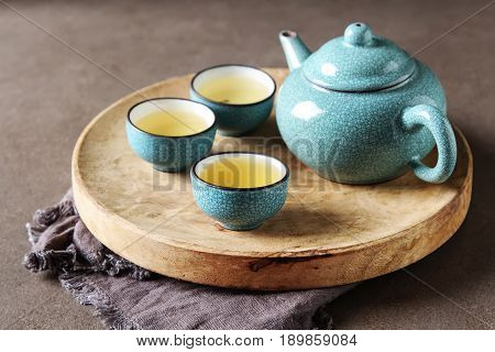 Porcelain chinese cups steel teaspoon. Black green puerh oolong tieguanyin sencha tea. Gray background poster