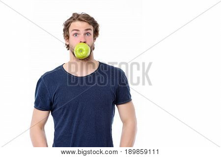 Young Guy With Amazed Facial Expression Holding Apple In Mouth
