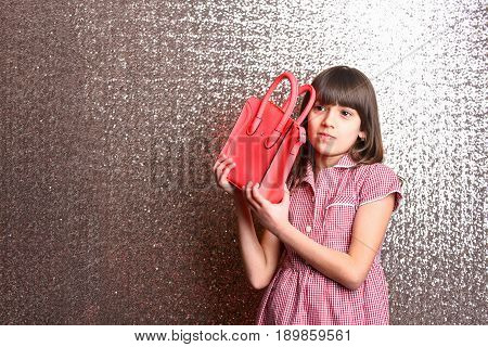 Small Pretty Smiling Girl With Fashionable Red Leather Bag