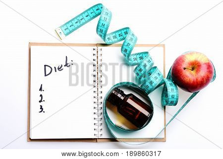 Notebook With Diet Plan, Twisted Blue Measuring Tape On It