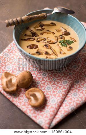 Cream Mushroom Soup in Bowl on Stone Background. Homemade Mushrooms Pottage Puree.