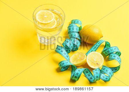 Measurement And Diet Concept. Measuring Tape, Lemon, Glass