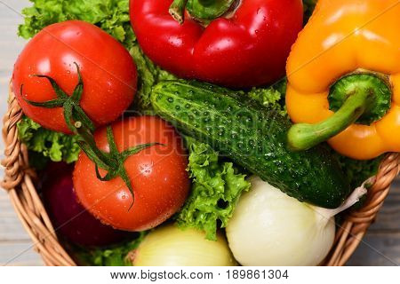 eco food concept vegetables or green lettuce leaf tomatoes with onions peppers cucumber in basket on blue vintage wooden background close up