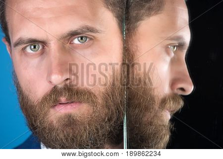 beard. face of serious bearded hipster man or businessman reflecting in mirror multifaceted business agile business success and vision barbershop and hair