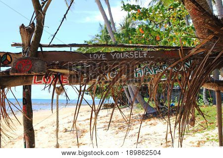 "Travel To Island Koh Lanta, Thailand. Inscriptions ""love Yourself"", ""love Peace Harmony"" On The Wood"