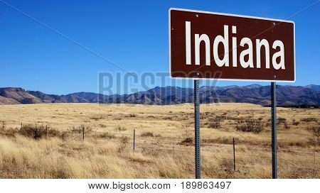 Indiana road sign with blue sky and wilderness