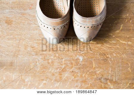 Beige Leather Shoes With Orthopedic Insoles. Wooden Background.