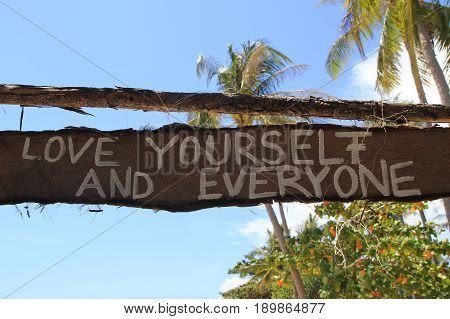 "Travel To Island Koh Lanta, Thailand. An Inscription ""love Yourself And Everyone"" On The Wooden Aban"