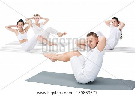 Multiethnic Girls With Instructor Doing Side Abdominal Crunches And Looking At Camera