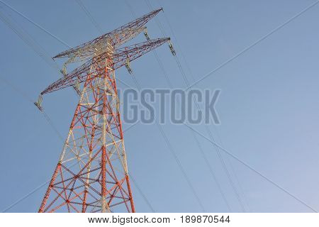 High voltage post and clear blue sky