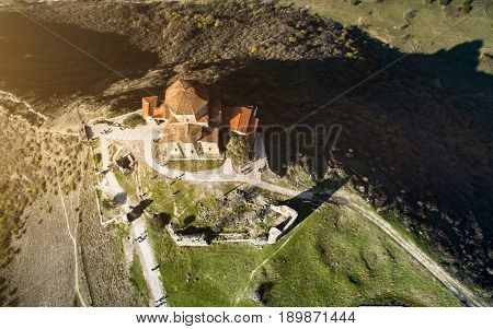Ancient jvari monastery with red rooftops, Mtskheta, Georgia, aerial shot taken with drone
