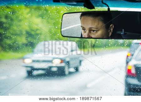 Woman driver. Reflection in the rearview mirror