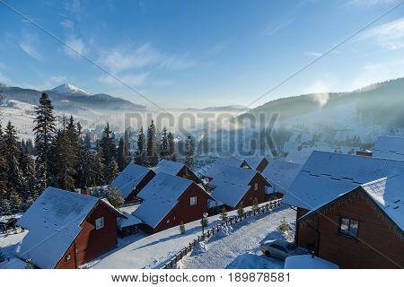 Winter landscape in mountains skiing resort of Bukovelhouses hotels shops and roads in Bukovel