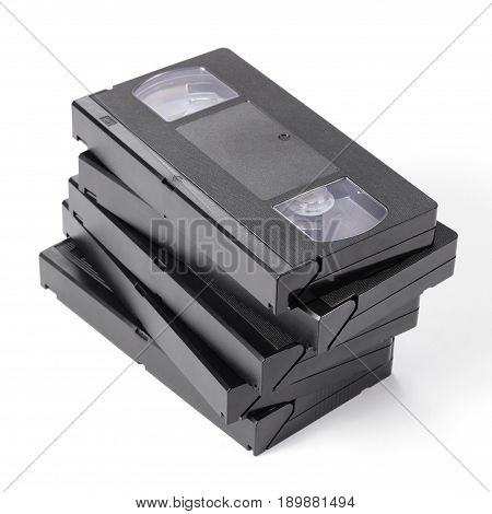 Pile of vintage VHS videotapes on a white background.