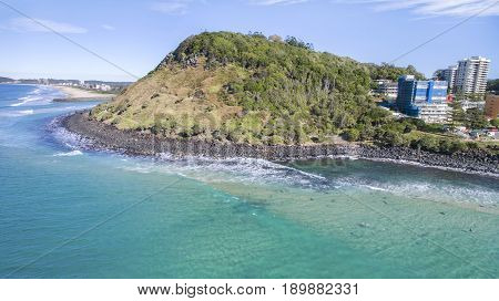 Aerial view of Burleigh Headland National Park and Tallebudgerra beach coastlines. Gold Coast, Australia