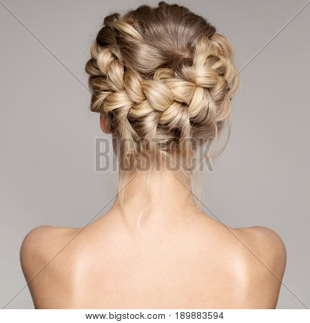 Portrait Of Beautiful Young Blond Woman With Braid Crown Hairstyle.