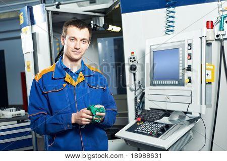 mechanical technician near cnc milling machine center at tool workshop