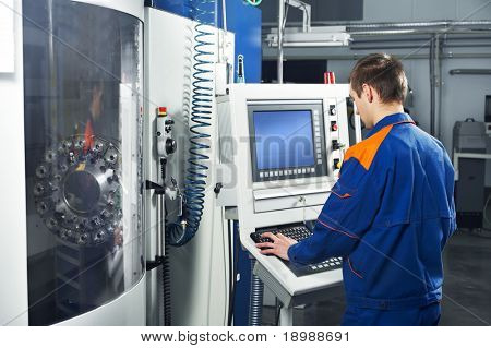 mechanical technician near cnc milling machine center at tool workshop poster