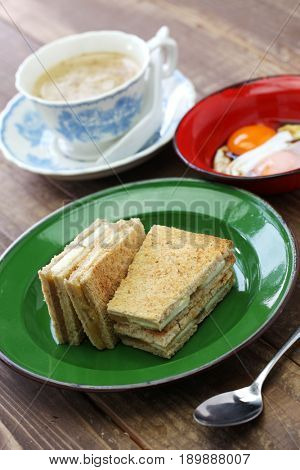 kaya jam toast with a cup of white coffee, singaporean malaysian breakfast
