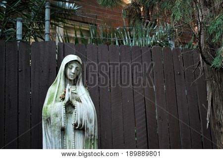 Old praying Nun statue in Peace Park of St. Canice's Parish