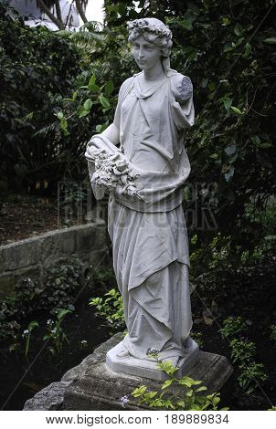 Spring figure statue. Heritage marble statuary at the Royal Botanic Gardens Sydney. Originating from 1875-1885
