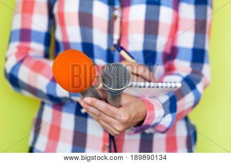 Journalist. News. Press conference. Media interview. Microphones. Journalism.