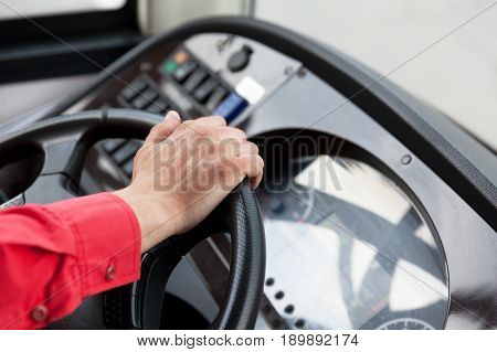 Hand close up of couch driver, driving passenger bus