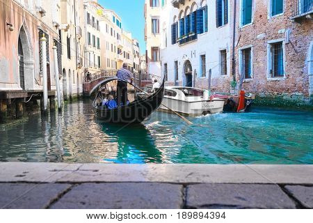 Venice, Italy, May, 31, 2017: landscape with the image of gondola on a channel in Venice, Italy