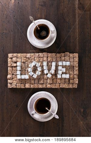 Word Love Made Of  Sugars And Cups Of Coffee