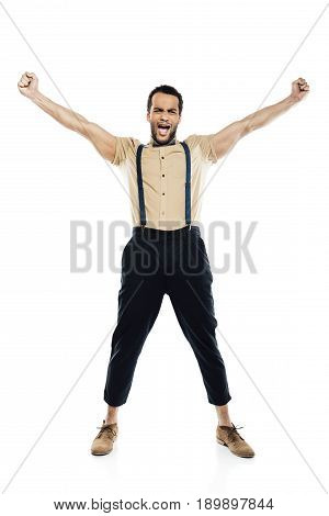 Cheerful African American Man Wearing In Suspenders And Bow Tie Yelling And Celebrating Success Isol