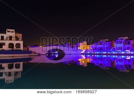 Night Panorama From Coast In Limassol, Cyprus Island, Mediterranean Sea. Colourful Bridge And Buildi