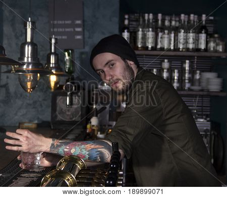 portrait of stylish barman making a cocktail in a bar