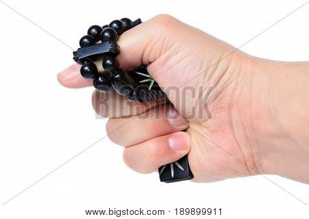 Rosary In Hand On A White Background Isolated