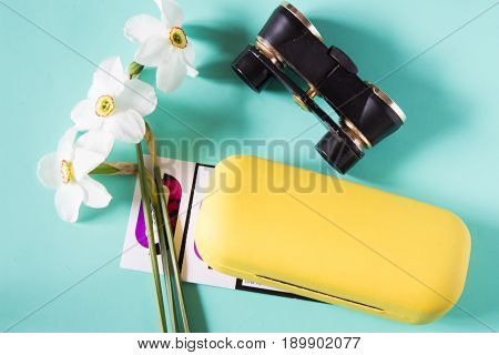 Black Binoculars, Narcissus Flowers, Eye Glasses Case And Theater Tickets. Trip To The Theater. Top