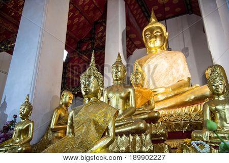 An gold Buddha in Thai Church with disciple