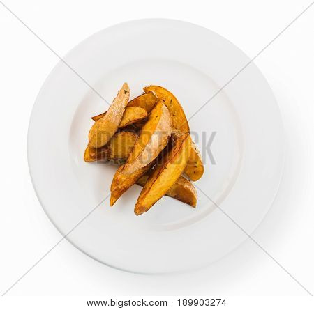 Delicious crispy baked potato wedges top view isolated on white