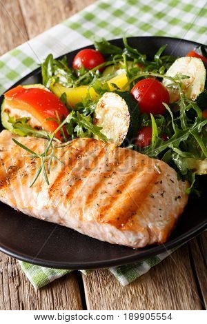 Dietary Food: Grilled Salmon And Vegetable Salad With Arugula Closeup. Vertical