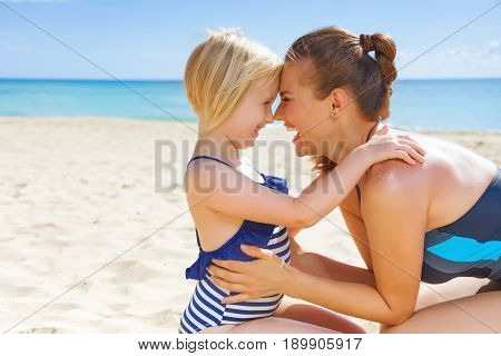 Happy Healthy Mother And Child On Seacoast Embracing