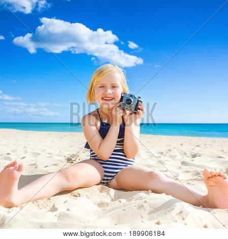 Happy Healthy Girl On Seacoast Showing Retro Photo Camera