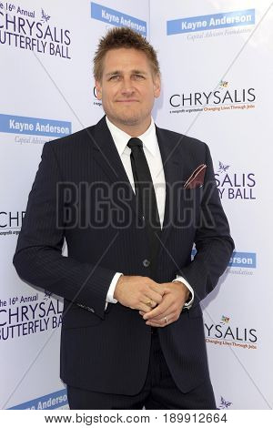 LOS ANGELES - JUN 3:  Curtis Stone at the 16th Annual Chrysalis Butterfly Ball at the Private Estate on June 3, 2017 in Los Angeles, CA