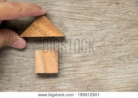 Wooden block puzzle in home shape wait for completion (Concept for family building or dream life)